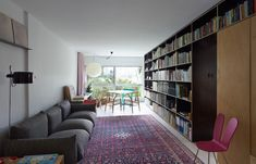Anthony Gill Architects. Love the curtain, which seems to slide along a track to cover the window when needed. Otherwise it remains against the wall, not blocking light. Click thru for a look at this clever apartment.