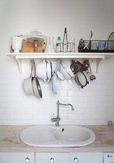 kitchen shelves, kitchen storage, apartment kitchen, kitchen spaces, kitchen sinks, subway tiles, storage ideas, hanging pots, kitchen tiles