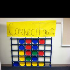 Life size connect four game - use  tape on the wall and different colored paper plates - Life Size Board Games Camp - only a pic