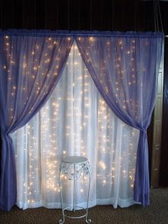 Curtain lights and sheer fabric would make a neat backdrop for a photo booth. #WeddingLights #PhotoBoothIdeas
