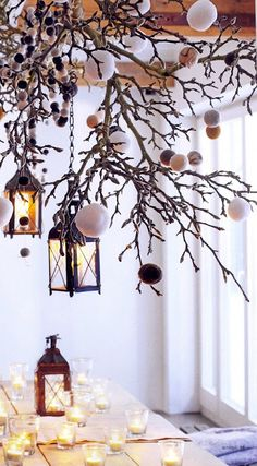 from Seasons November-December 2010:: pretty Christmas tablescape with lanterns, candles, and branches. Very winter wonderland.