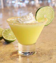 Key Lime Martini...1 oz. Ciroc Coconut Vodka     1 oz. Pinnacle Whipped Vodka     .5 oz. pineapple juice     .25 oz. cream of coconut     Crushed graham cracker, whipped cream, and lime slice for garnish
