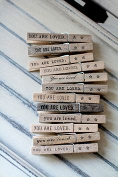 Clothespins - escort card holder, note holder, photo clipper - you are loved. (set of 12). $15.00, via Etsy.