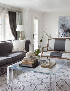 Love the coffee table and stripe sofa.