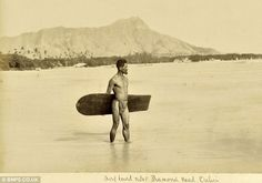 """1890 - This is the first known photograph ever taken of a surfer. Surfing was banned in Hawaii by missionaries in the 1700s for its """"ungodliness,"""" but fortunately the natives didn't pay much heed to that decree."""