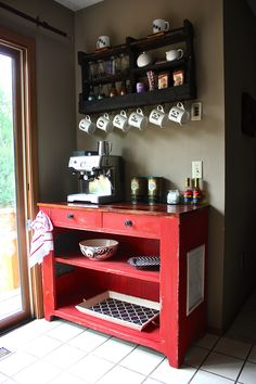 Repurposed antique pie safe turned into an at home coffee bar. Color: Crimson Red. Coffee shelf from DelHutsonDesigns via etsy.com