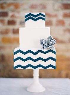 Gorgeous white cake with blue chevron stripe from Sweet & Saucy Shop