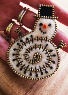 Felt and zipper snowman brooch