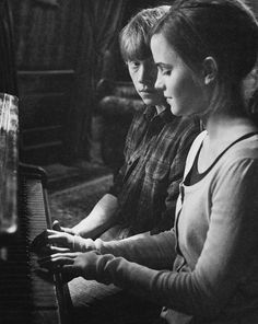 Ron and hermione. I love the way he looks at her.