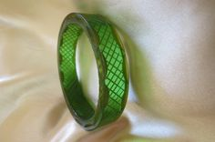 Transparent green and gold carved vintage bakelite bangle~check for availability!