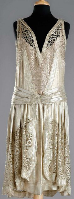 Charleston dress, 1920. Attached under-dress. Gold silk lamé with metallic lace, embroidered with Swarovski crystals and beads.