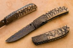 South African knifemaker George Muller created this exceptional knife at a remarkably low price. The bolsters and hollow ground blade are made from gorgeous Damascus. The spine of the blade and titanium liners have been beautifully file-worked. Fossil mammoth ivory scales are dovetailed to the Damascus bolsters. An exceptional custom knife with incredible fit and finish.