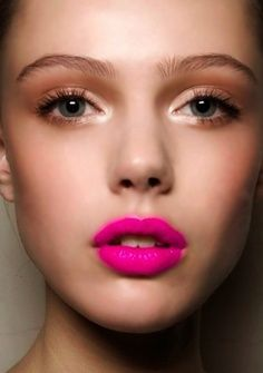 Bold pink lip, soft eyes