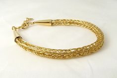 This 14K gold filled wire classic Viking knit bracelet is handmade by DianaShyeJewelry on Etsy.  $84