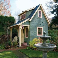 we want to do this with our little cottage in back...love the sidewalk & small front porch. Color of the cottage is so pretty with its contrasting trim...