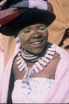 A Xhosa woman wearing a necklace, telling us that she is a nursing mother.