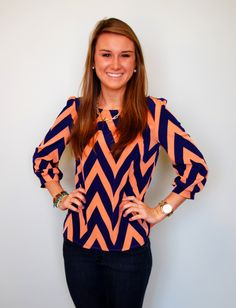 This peach and navy chevron top goes great with jeans! Wear it with white skinnies in the spring for a fresh look. Model is 5'4 and is wearing a size small.