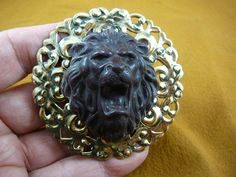 Lion roaring wild lions 3-D head cameo pin pendant BRASS brooch cl91-3. $38.99, via Etsy.