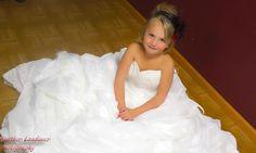 Daughter wearing her mothers wedding dress