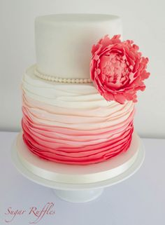 Pretty pink and white cake with ruffles and peony.