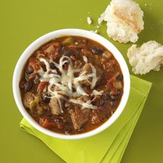 """Chipotle-Black Bean Chili Recipe    This thick, slow-cooked chili is special because it """"cooks itself"""". It's really nice served with corn bread."""