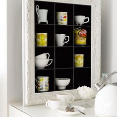 Shelves and squares for everything in the kitchen.  A fantasy world of organization.