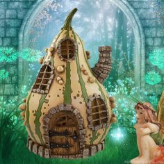 Striped Gourd Fairy House in the green fairy garden.