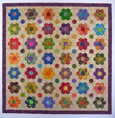 """Wow, that's some """"flower power.""""  Love this hexagon quilt."""