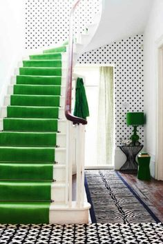 Talk about the color of the year! I love this emerald stair runner combined with a black and white hall.