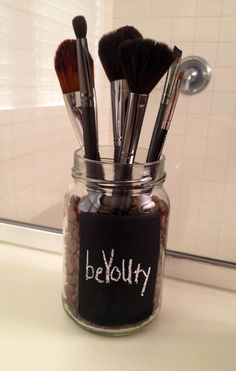 Store brushes in an up cycled jar filled with coffee beans.  The brushes smell like coffee and it's an instant pick me up in the morning!
