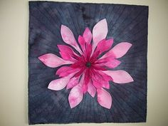 3 D Flower  By: Jackie, Ontario, Canada  Blog: Jackie's Jumble of Life  This is a 3D flower made with hand dyed fabrics. It may be difficult to see but the petals actually are off the background, literally 3D. The centre is beaded heavily.