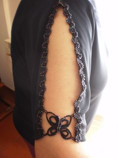 Use a Tee shirt, slit the sleeve and edge with crochet or tatted lace.... AWESOME!