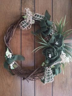 Burlap ribbon flowers, some pearls and greenery. Loving using the burlap for a wreath.