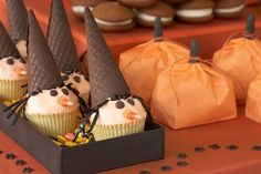 How cute is this?!! Chocolate cone hats, licorice hair, chocolate chip eyes and a candy corn nose. Adorable!
