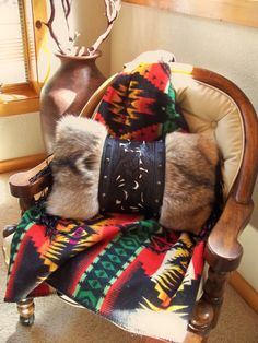 Hand crafted leather and coyote fur Western style pillow, by Stargazer Mercantile,