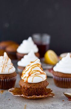 Gingerbread Cupcakes with Marshmallow Frosting & Pomegranate Caramel #cupcakes #cupcakesrecipes http://thecupcakedailyblog.com/gingerbread-cupcakes-with-marshmallow-frosting/