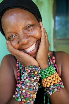 World Fair Trade Organization (WFTO) #FairTrade can make the world a better place for millions by changing lives like Joane's #ChaneTheWorld #SupportFairTrade smiling woman with beads  Spread by www.compassionateessentials.com and http://stores.ebay.com/fairtrademarketplace/ stores supporting #fairtrade.