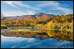 Mt. Ascutney, standing at 3,143ft, reflects off a glass like Connecticut River on a beautiful fall day in Vermont.