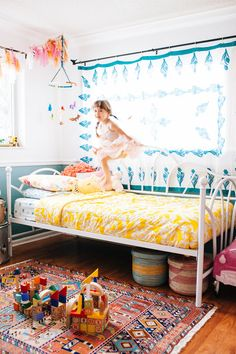 This colorful bedroom is a perfect collection of new, vintage and handmade.