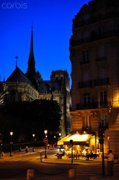 France, Paris, Notre Dame church and a cafe at dusk