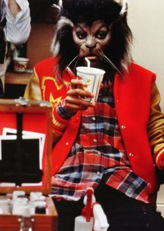 Michael Jackson having a little drinky-poo while in Rick Baker's fantastic Thriller makeup.
