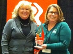 Angela McCathran (left), '01, is the president and CEO of Peoples Trust Federal Credit Union in Houston, Texas.