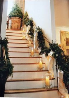 christmas stockings and candles up the stairway....