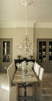 Crystal chandelier + rustic dining table = decorating success!