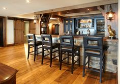 Love the rustic bar and the barn doors!