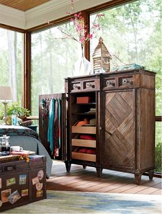 Much easier to keep organized than a dresser / Stay organized behind closed doors with this versatile Woodlands Chifforobe.