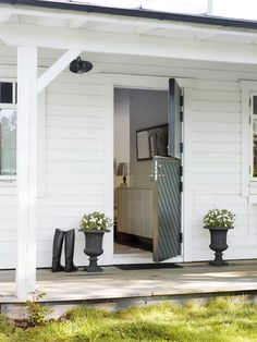 farmhouse entry: love the doors and the porch