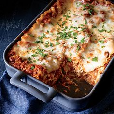 Classic Lasagna with Meat Sauce: Extra-lean ground beef (which sometimes cooks up dry) works well here because it's combined with marinara to keep it moist. | Cooking Light #myplate #dairy #protein #wholegrain