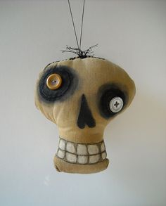 skull ornament, looks easy enough to DIY. Just cut the fabric pieces, sew, stuff, add black paint/ink and buttons...
