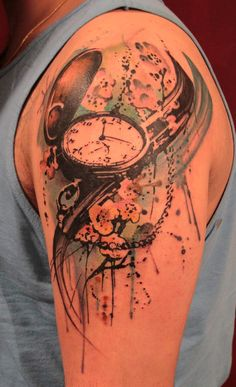 By Gene Coffey at Tattoo Culture.  I've always really liked this watercolor style of tattoo... anybody know how they hold up over time?  It seems like fading would be a concern.